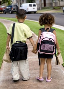 Brother and sister walking to school